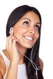 Música que escucha de la chica joven ocasional Fotografía de archivo