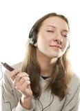 Música que escucha de la muchacha adolescente Fotos de archivo