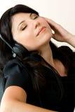 Música que escucha de la mujer Imagen de archivo libre de regalías