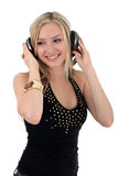 Música que escucha de la mujer joven Fotos de archivo
