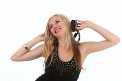Música que escucha de la mujer joven Foto de archivo libre de regalías
