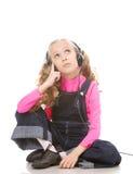 Música que escucha de la niña Imagen de archivo libre de regalías
