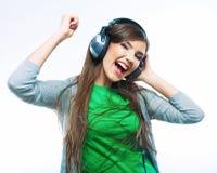 Música que escucha de las mujeres jovenes Baile de la muchacha del adolescente Fotos de archivo