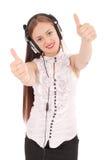 Música que escucha del adolescente bonito en sus auriculares Imagenes de archivo