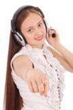 Música que escucha del adolescente bonito en sus auriculares Foto de archivo