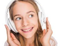 Música que escucha del adolescente con los auriculares Fotografía de archivo