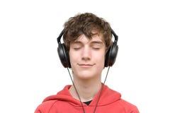 Música que escucha del adolescente con los auriculares Imagen de archivo