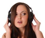 Música que escucha del adolescente en los auriculares Fotografía de archivo