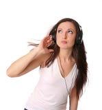 Música que escucha del adolescente en los auriculares Foto de archivo