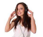 Música que escucha del adolescente en los auriculares Imágenes de archivo libres de regalías