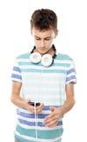 Música que escucha del adolescente en los auriculares Imagen de archivo libre de regalías