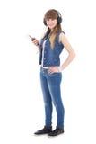 Música que escucha del adolescente hermoso con el aislante del teléfono móvil Imagen de archivo libre de regalías