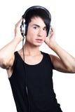 Música que escucha del hombre joven Fotos de archivo