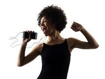 Música que escucha i del adolescente de la muchacha de la mujer del baile feliz joven del bailarín Fotos de archivo