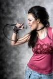 Música rock del canto de la hembra Fotografía de archivo
