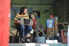 Músico con Accordian en el boca del La, la Argentina Fotos de archivo