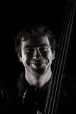 Músico considerável que sorri extensamente Fotos de Stock