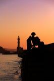 Músico de la calle en puesta del sol Fotos de archivo libres de regalías