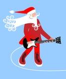 Músico do Natal de Santa Fotografia de Stock Royalty Free