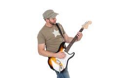 Músico que joga a guitarra elétrica com entusiasmo Isolado no branco foto de stock