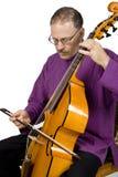 Músico que joga um instrumento Fotografia de Stock Royalty Free