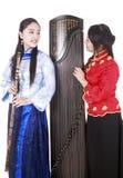 Músicos de sexo femenino chinos fotos de archivo