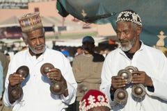 Músicos en el EL Fna, Marrakesh de Djemaa foto de archivo