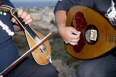 Músicos tradicionales del Cretan Fotografía de archivo