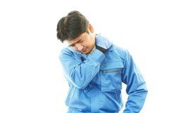 Müde asiatische Arbeitskraft lizenzfreies stockbild