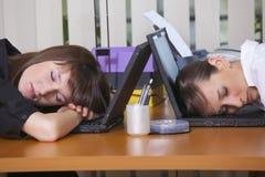 Müde Büroangestellte Stockfotos