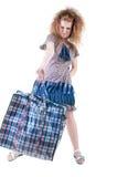Müde Frau mit Einkaufstasche. Lizenzfreies Stockfoto