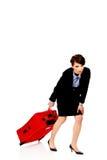 Müde Geschäftsfrau mit Koffer lizenzfreie stockfotografie