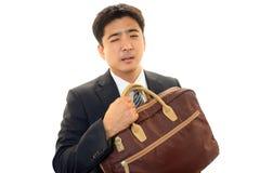 Müder asiatischer Geschäftsmann Stockfotografie