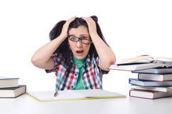 Müder Kursteilnehmer mit Lehrbüchern Stockfotos