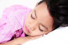 Schlafendes junges Mädchen Stockbilder