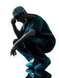 Müdes Schattenbild der Doktorchirurgmann-Verzweiflung Stockfoto