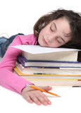 Müdes Schule-Mädchen, das ihre Heimarbeit tut Lizenzfreies Stockbild