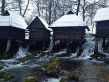 Mühle auf Wasser Stockfotos