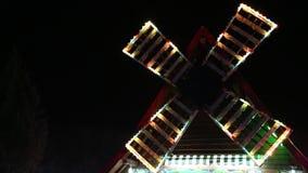 Mühle geschmückt mit Lichtern stock video