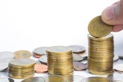Münze auf weißem Hintergrund Stockfotos