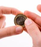 Münze in der Hand Lizenzfreie Stockfotos
