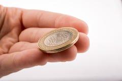 Münze in der Hand Stockbild