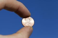 Münze in der Hand Lizenzfreie Stockbilder