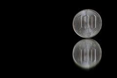 Münze der japanischen Yen auf Schwarzem Lizenzfreies Stockbild