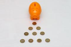 Münze des Sparschweins und zehn Rupie von Indien Stockfotografie