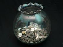 Münze im Glas Stockfoto