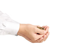 Münze zum Geld in der Hand Lizenzfreies Stockfoto