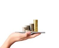 Münze zum Geld, Geschäftsideen in der Hand Stockfotografie