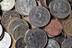 Münzen als Hintergrund Stockbilder