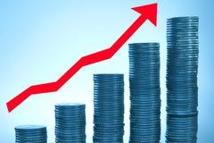 Münzen auf blauem Hintergrund Stockfoto